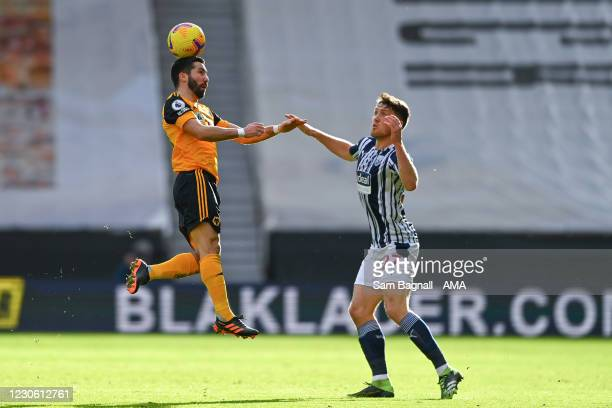 Joao Moutinho of Wolverhampton Wanderers and Dara OShea of West Bromwich Albion during the Premier League match between Wolverhampton Wanderers and...