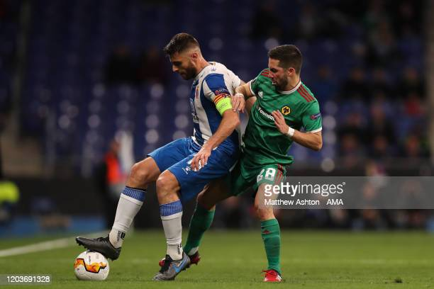 Joao Moutinho of Wolverhampton Wanderers and David Lopez of Espanyol during the UEFA Europa League round of 32 second leg match between Espanyol...