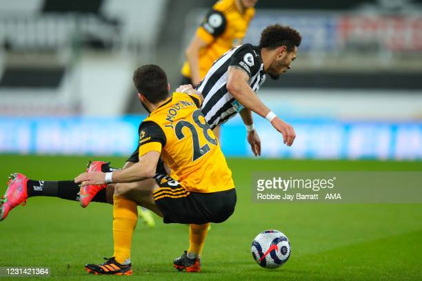 Joao Moutinho of Wolverhampton Wanderers and Joelinton of Newcastle United during the Premier League match between Newcastle United and Wolverhampton...