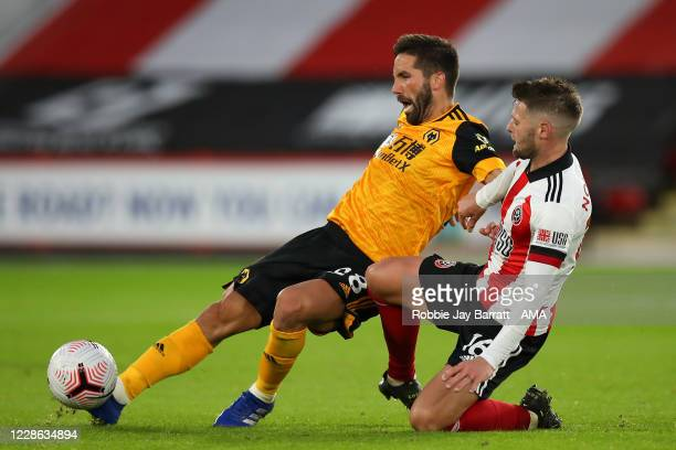 Joao Moutinho of Wolverhampton Wanderers and Oliver Norwood of Sheffield United during the Premier League match between Sheffield United and...