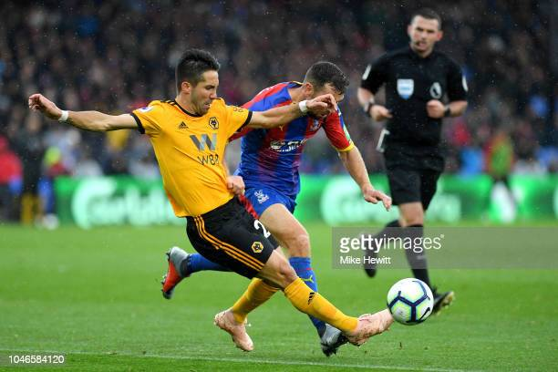 Joao Moutinho of Wolverhampton Wanderers battles for possession with James McArthur of Crystal Palace during the Premier League match between Crystal...