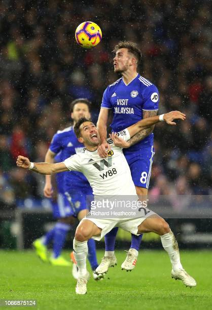 Joao Moutinho of Wolverhampton Wanderers battles for the ball with Joe Ralls of Cardiff City during the Premier League match between Cardiff City and...