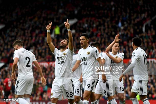 Joao Moutinho of Wolverhampton Wanderers celebrates after scoring a goal to make it 1-1 during the Premier League match between Manchester United and...