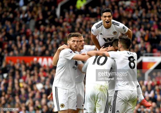 Joao Moutinho of Wolverhampton Wanderers celebrates after scoring a goal to make it 1-1 with Raul Jimenez of Wolverhampton Wanderers during the...