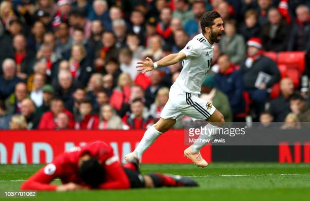 Joao Moutinho of Wolverhampton Wanderers celebrates after scoring his team's first goal during the Premier League match between Manchester United and...