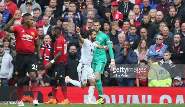 Joao Moutinho of Wolverhampton Wanderers celebrates scoring their first goal during the Premier League match between Manchester United and...
