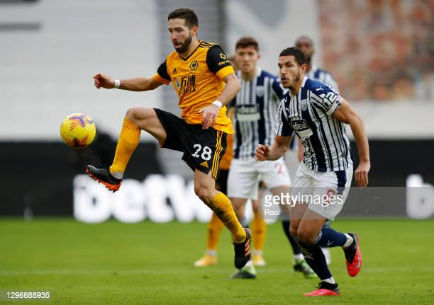Joao Moutinho of Wolverhampton Wanderers controls the ball under pressure from Jake Livermore of West Bromwich Albion during the Premier League match...