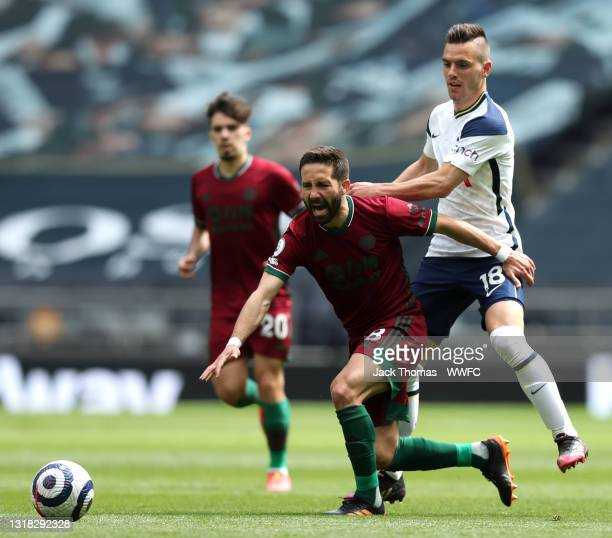 Joao Moutinho of Wolverhampton Wanderers is challenged by Giovani Lo Celso of Tottenham Hotspur during the Premier League match between Tottenham...