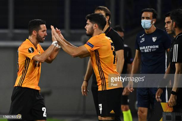Joao Moutinho of Wolverhampton Wanderers is replaced by teammate Pedro Neto during the UEFA Europa League Quarter Final between Wolves and Sevilla at...