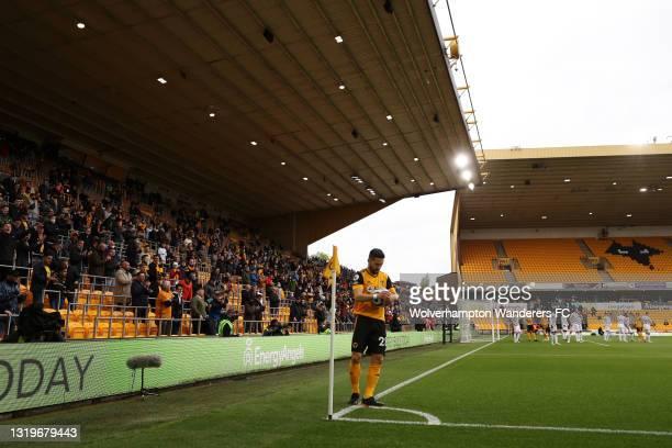 Joao Moutinho of Wolverhampton Wanderers prepares to take a corner kick during the Premier League match between Wolverhampton Wanderers and...