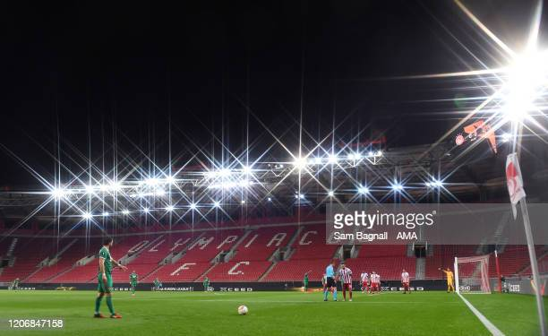 Joao Moutinho of Wolverhampton Wanderers prepares to take a free kick in the empty stadium during the UEFA Europa League round of 16 first leg match...