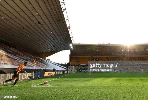 Joao Moutinho of Wolverhampton Wanderers takes a corner in front of a empty stand during the Premier League match between Wolverhampton Wanderers and...