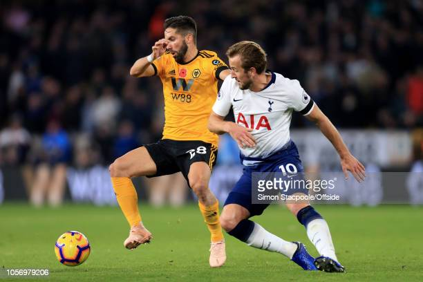 Joao Moutinho of Wolves battles with Harry Kane of Spurs during the Premier League match between Wolverhampton Wanderers and Tottenham Hotspur at...