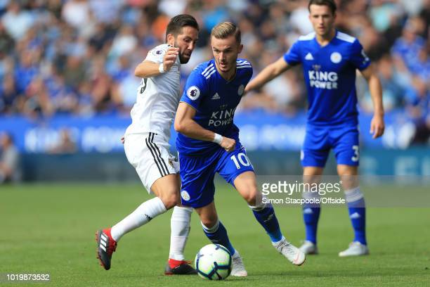 Joao Moutinho of Wolves battles with James Maddison of Leicester during the Premier League match between Leicester City and Wolverhampton Wanderers...