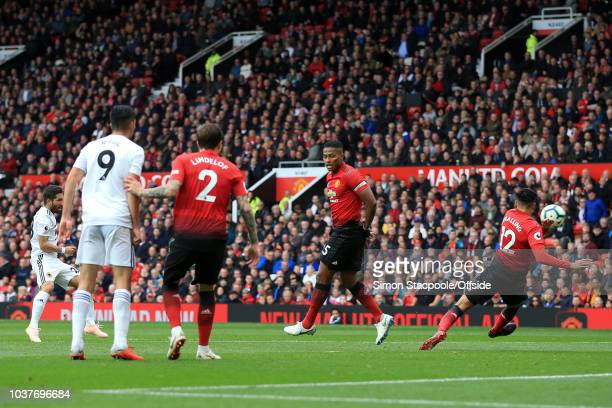 Joao Moutinho of Wolves scores their 1st goal during the Premier League match between Manchester United and Wolverhampton Wanderers at Old Trafford...