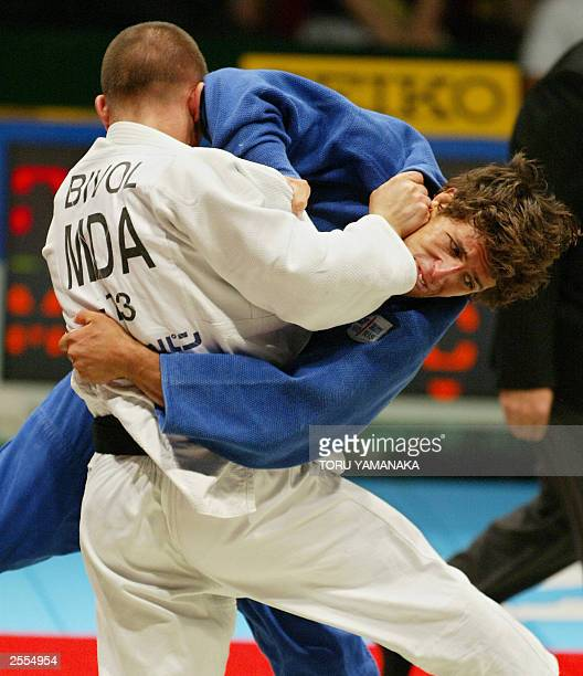 Joao Neto of Portugal fights with Victor Bivol of Moldova during men's 73kg third place match in the World Judo Championships in Osaka western Japan...