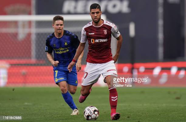 Joao Novais of SC Braga with Dominik Kaiser of Brondby IF in action during the UEFA Europa League Third Qualifying Round match between SC Braga and...