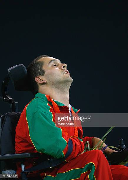 Joao Paulo Fernandes of Portugal celebrates on the podium after winning the gold medal in the BC4 Boccia at the Fencing Hall of National Convention...