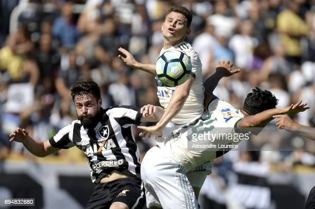 Joao Paulo of Botafogo battles for the ball with Jonas and Werley of Coritiba during the match between Botafogo and Coritiba as part of Brasileirao...