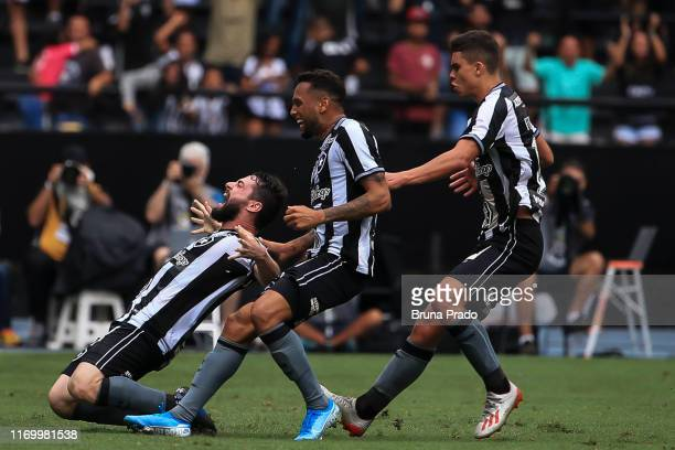 Joao Paulo of Botafogo celebrates with a teammates after scoring a goal during a match between Botafogo and Sao Paulo as part of Brasileirao Series A...