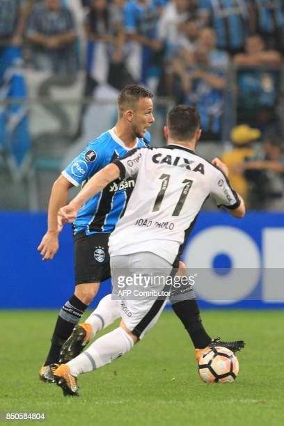 Joao Paulo of Botafogo vies for the ball with Arthur of Gremio during their Copa Libertadores 2017 football match held at the Arena do Gremio stadium...