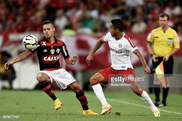 Joao Paulo of Flamengo battles for the ball with Jorge Henrique of Internacional during a match between Flamengo and Internacional as part of...