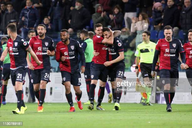 Joao Pedro and Charalambos Lykogiannis of Cagliari celebrate victory at the end of the Serie A match between Cagliari and ACF Fiorentina at Sardegna...