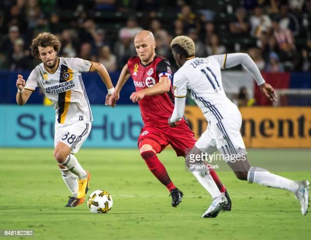 Joao Pedro and Gyasi Zardes of Los Angeles Galaxy battles Michael Bradley of Toronto FC during the Los Angeles Galaxy's MLS match against Toronto FC...