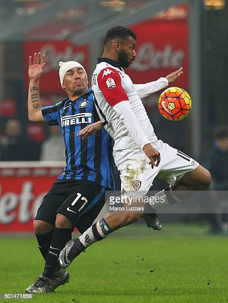 Joao Pedro Dos Santos Galvao of Cagliari Calcio competes for the ball with Gary Alexis Mede of FC Internazionale Milano during the TIM Cup match...