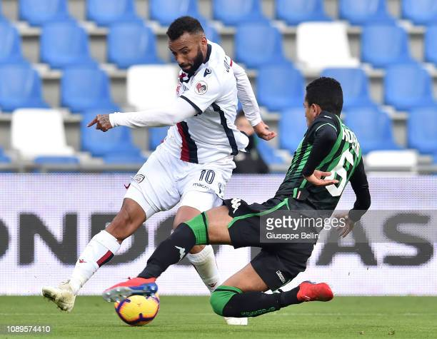Joao Pedro of Cagliari and Rogerio of US Sassuolo in action during the Serie A match between US Sassuolo and Cagliari at Mapei Stadium Citta' del...