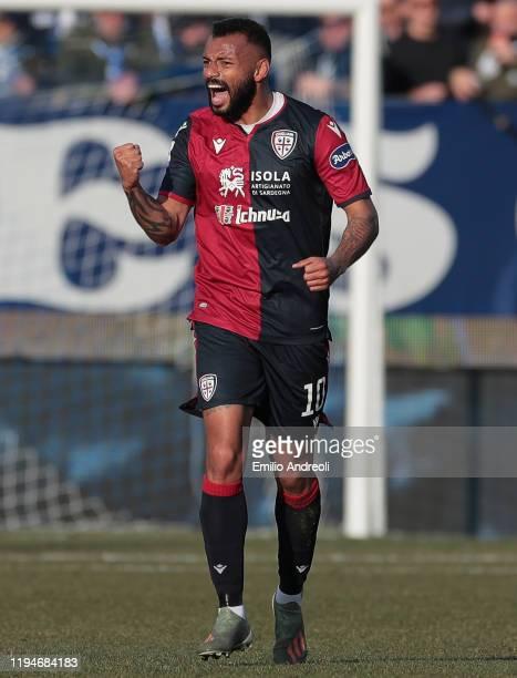 Joao Pedro of Cagliari Calcio celebrates after scoring the opening goal during the Serie A match between Brescia Calcio and Cagliari Calcio at Stadio...