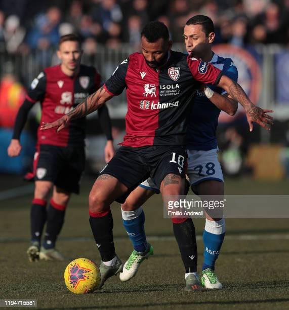 Joao Pedro of Cagliari Calcio is challenged by Romulo of Brescia Calcio during the Serie A match between Brescia Calcio and Cagliari Calcio at Stadio...