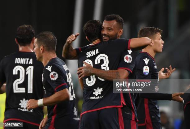Joao Pedro of Cagliari celebrates his first goal with his teammates during the Serie A match between Juventus and Cagliari on November 3 2018 in...