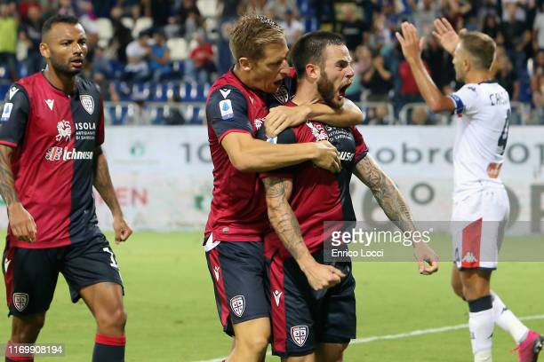 Joao Pedro of Cagliari celebrates with teammates after a Genoa CFC own goal makes it 31 during the Serie A match between Cagliari Calcio and Genoa...