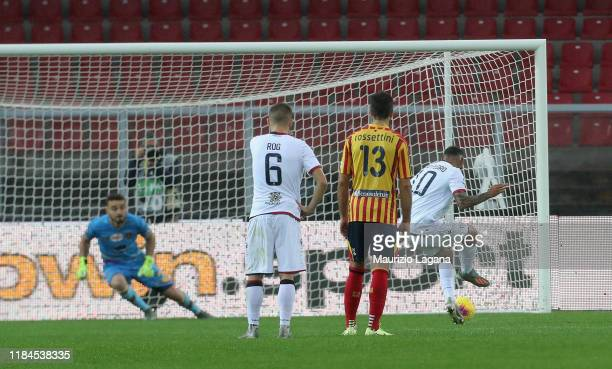 Joao Pedro of Cagliari scores the opening with penalty goal during the Serie A match between US Lecce and Cagliari Calcio at Stadio Via del Mare on...