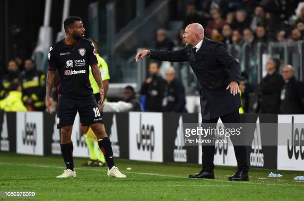 Joao Pedro of Cagliari speaks with head coach of Cagliari Rolando Maran during the Serie A match between Juventus and Cagliari on November 3 2018 in...