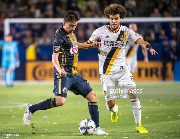Joao Pedro of Los Angeles Galaxy battles Alejandro Bedoya of Philadelphia Union during Los Angeles Galaxy's match against Philadelphia Union at the...