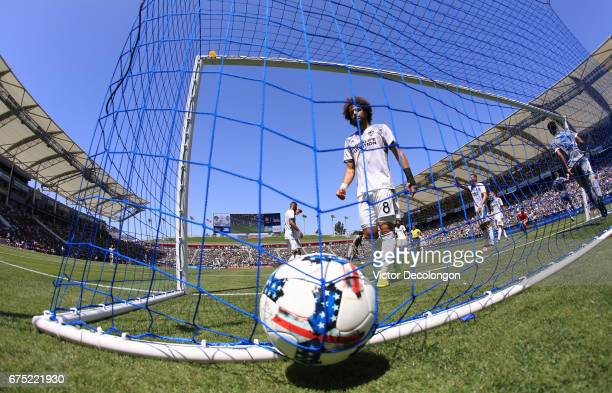 Joao Pedro of Los Angeles Galaxy walks toward the ball in the net after a goal by Jordan Morris of the Seattle Sounders FC during the first half of...