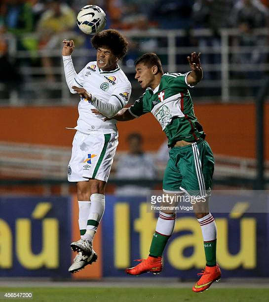 Joao Pedro of Palmeiras fights for the ball with Nene of Chapecoense during the match between Palmeiras and Chapecoense for the Brazilian Series A...