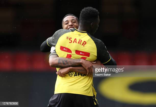 Joao Pedro of Watford celebrates with Ismaila Sarr after scoring his team's first goal during the Sky Bet Championship match between Watford and...