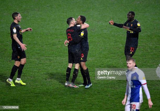 Joao Pedro of Watford celebrates with team mate Tom Cleverley after scoring their side's first goal during the Sky Bet Championship match between...
