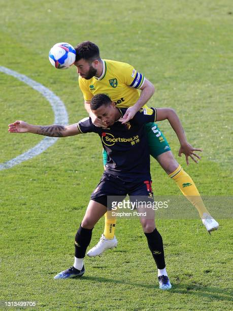 Joao Pedro of Watford FC and Grant Hanley of Norwich City battle for the ball during the Sky Bet Championship match between Norwich City and Watford...