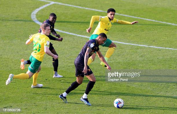 Joao Pedro of Watford FC prepares to strike the ball under pressure from Oliver Skipp of Norwich City during the Sky Bet Championship match between...