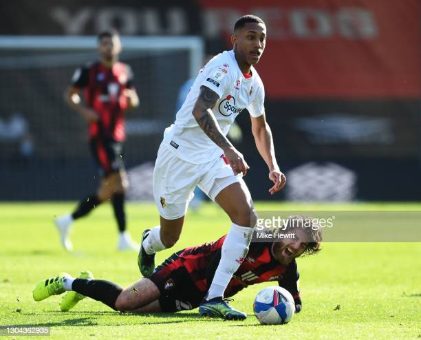 Joao Pedro of Watford is challenged by Ben Pearson of AFC Bournemouth during the Sky Bet Championship match between AFC Bournemouth and Watford at...
