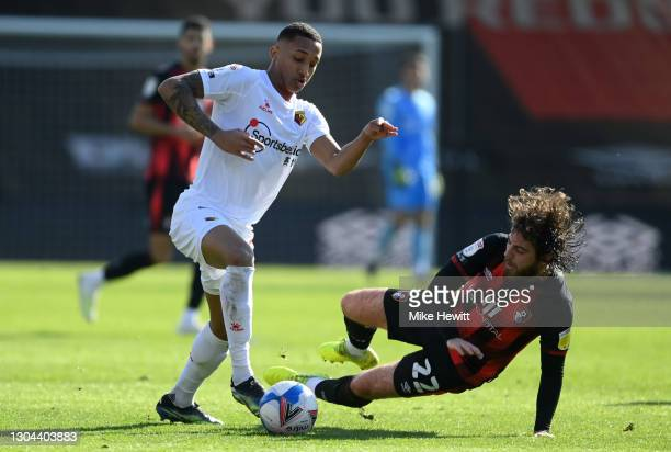 Joao Pedro of Watford is challenged by Ben Pearson of Bournemouth during the Sky Bet Championship match between AFC Bournemouth and Watford at...