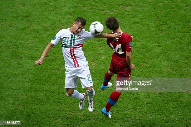 Joao Pereira of Portugal and Vaclav Pilar of Czech Republic jump for the ball during the UEFA EURO 2012 quarter final match between Czech Republic...