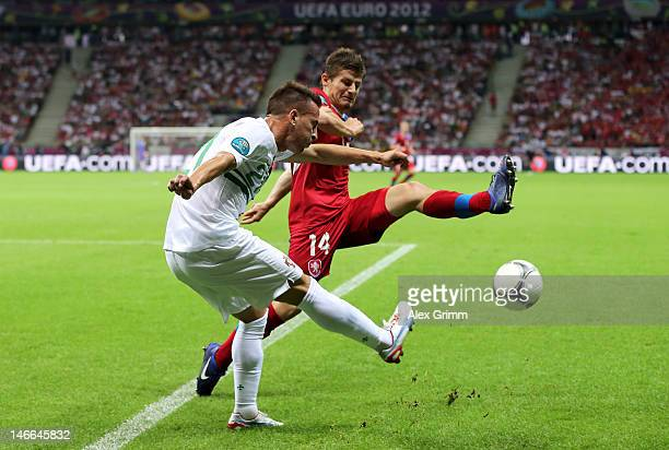 Joao Pereira of Portugal crosses the ball as Vaclav Pilar of Czech Republic attempts to block during the UEFA EURO 2012 quarter final match between...