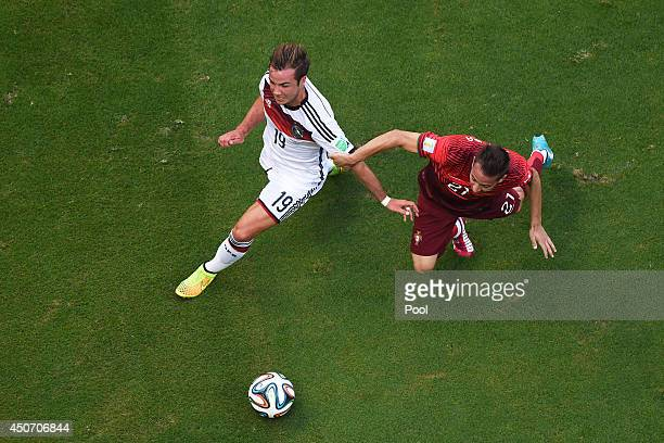 Joao Pereira of Portugal fouls Mario Goetze of Germany leading to a penalty kick during the 2014 FIFA World Cup Brazil Group G match between Germany...