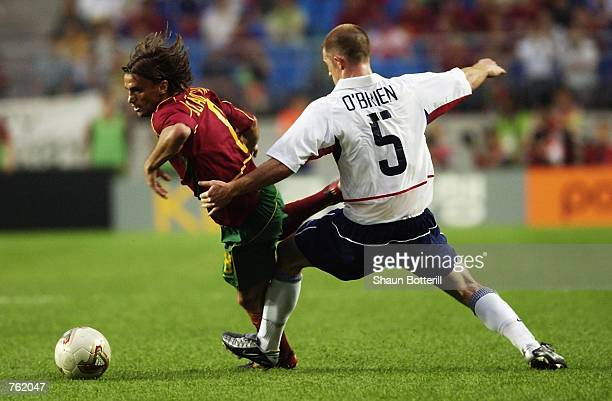 Joao Pinto of Portugal evades the challenge of John O'Brien of the USA during the second half during the Portugal v USA, Group D, World Cup Group...