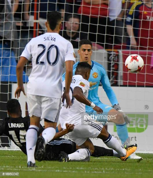 Joao Plata of Real Salt Lake misses this shot on goal while goalie Joel Castro Pereira of Manchester United looks on during the first half of the...